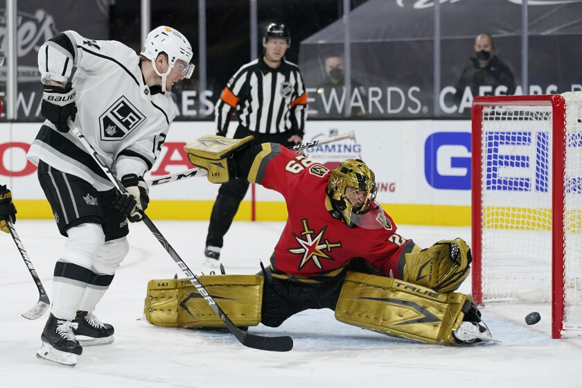 Vegas Golden Knights goaltender Marc-Andre Fleury (29) blocks a shot by Los Angeles Kings' Lias Andersson, left, during the third period of an NHL hockey game Wednesday, March 31, 2021, in Las Vegas. (AP Photo/John Locher)