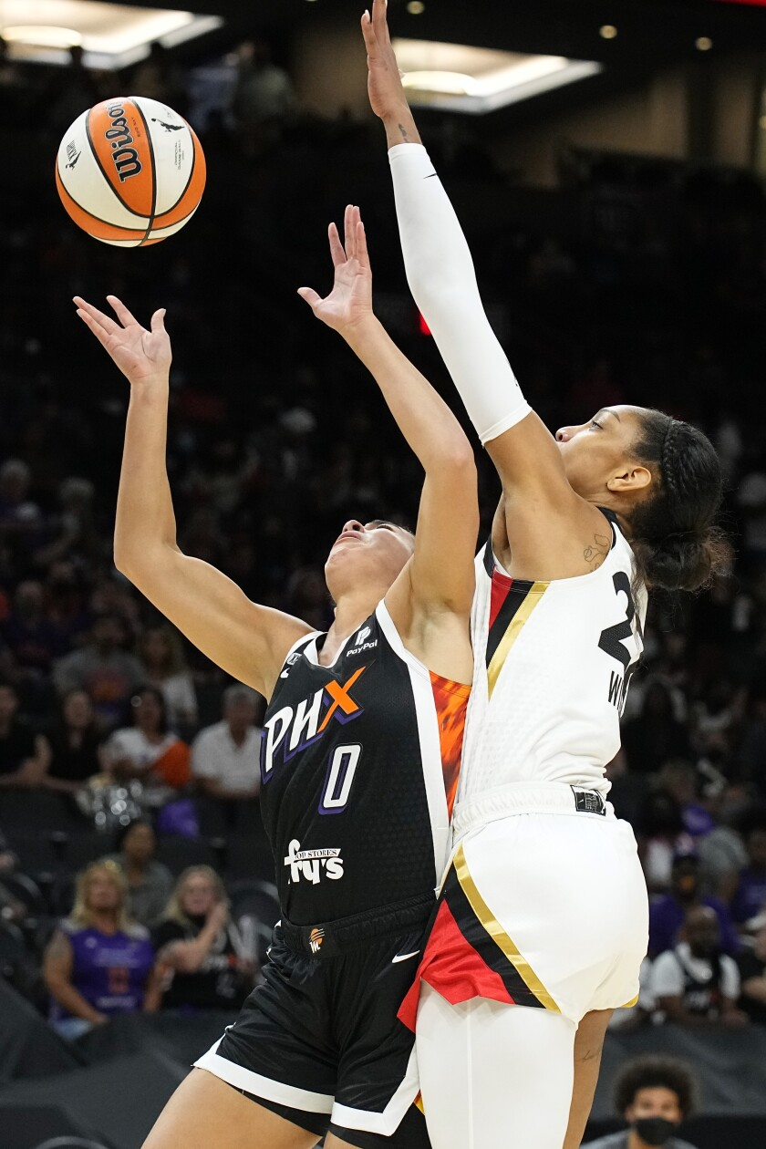 Las Vegas Aces forward A'ja Wilson (22) blocks a shot by Phoenix Mercury guard Kia Nurse during the first half of Game 4 of a WNBA basketball playoff series Wednesday, Oct. 6, 2021, in Phoenix. Nurse was hurt on the play and did not play again in the first half. (AP Photo/Rick Scuteri)