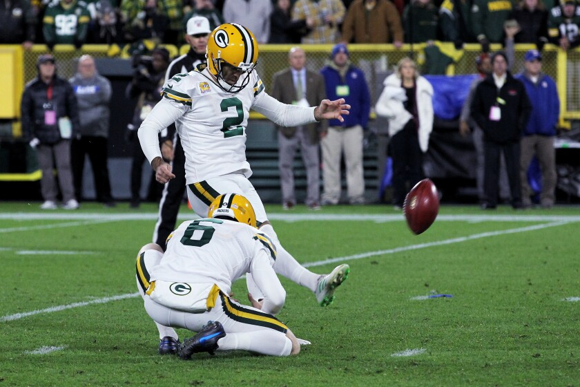 Green Bay kicker Mason Crosby converts on a field-goal attempt as time expires to lift the Packers over the Detroit Lions 23-22 on Monday.