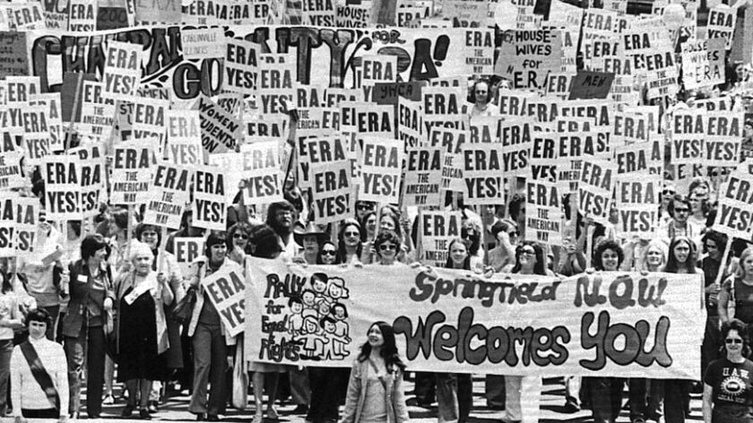 An estimated 10,000 marchers descend on the Capitol building in Springfield, Ill to demonstrate for the passage of the Equal Rights Amendment on May 16, 1976.