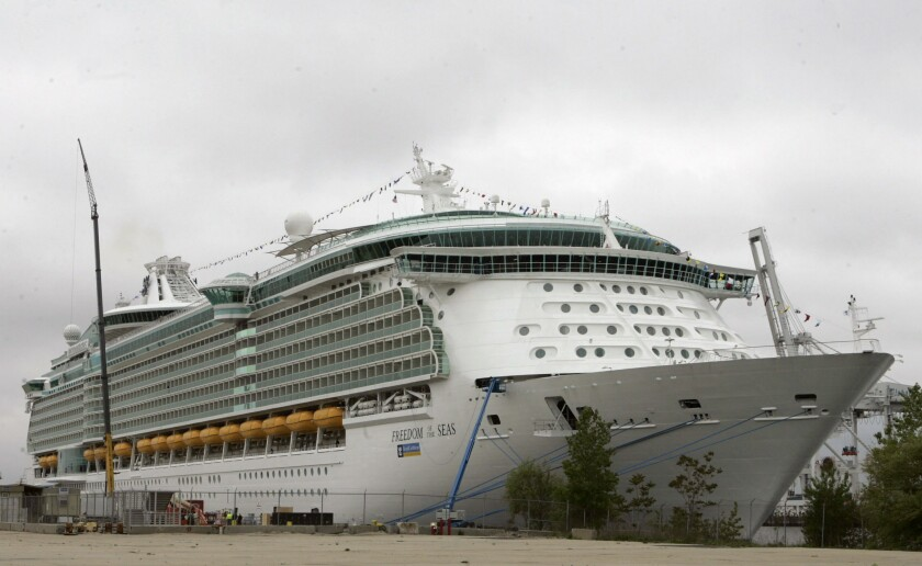 """FILE - This May 11, 2006 file photo shows the Freedom of the Seas cruise ship docked in Bayonne, N.J. An Indiana man charged with negligent homicide in his granddaughter's fatal plunge from a cruise ship docked in Puerto Rico insists that he didn't realize an 11th-floor window was open before the 18-month-old fell to her death in July. Salvatore Anello of Valparaiso tells """"CBS This Morning"""" that Chloe Wiegand fell after he lifted her to a window on the Royal Caribbean's Freedom of the Seas so she could bang on the glass like she did at hockey games. (AP Photo/Mike Derer, File)"""