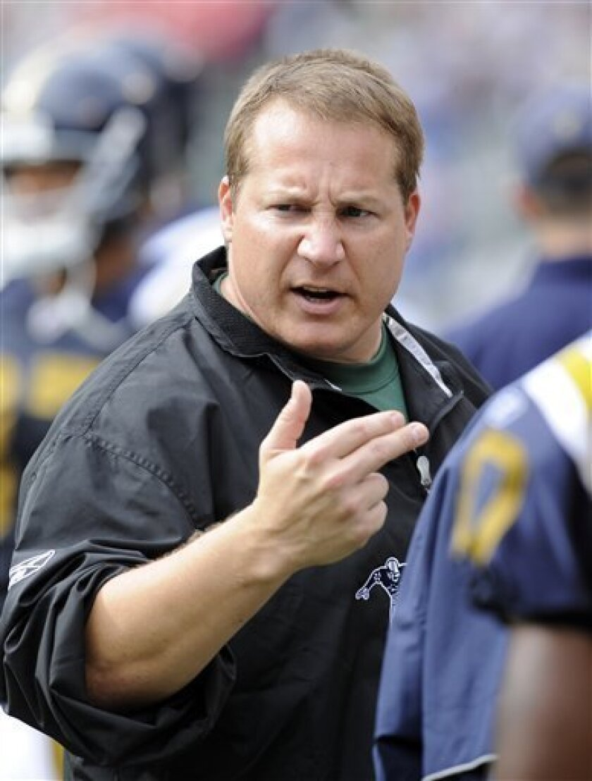 In this  Sept. 28, 2008 file photo, New York Jets coach Eric Mangini gestures on the sidelines during the third quarter of an NFL football game against the Arizona Cardinals at Giants Stadium in East Rutherford, N.J. The Cleveland Browns have agreed to hire Eric Mangini as their head coach, a pers