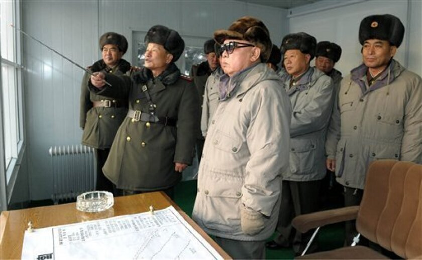 In this undated photo released by Korean Central News Agency on Friday, Dec. 31, 2010 and distributed by Korea News Service in Tokyo on Sunday, Jan. 2, 2011, North Korean leader Kim Jong Il, supreme commander of the Korean People's Army, center, watches training of Seoul Ryu Kyong Su 105 Guards Tank Division of the KPA in North Korea. (AP Photo/Korean Central News Agency via Korea News Service) JAPAN OUT