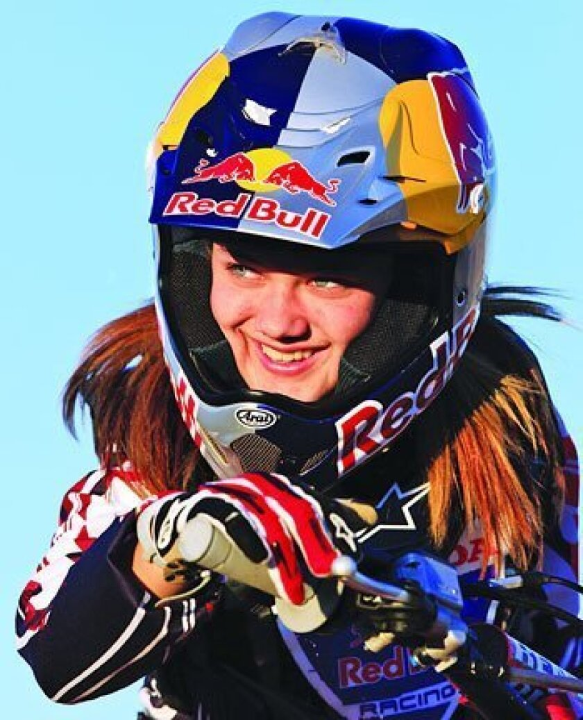 The 18-year-old Ashley Fiolek rides fast in the noisy, chaotic sport of motocross, despite being deaf. <em>(Photos by Simon Cudby)</em>