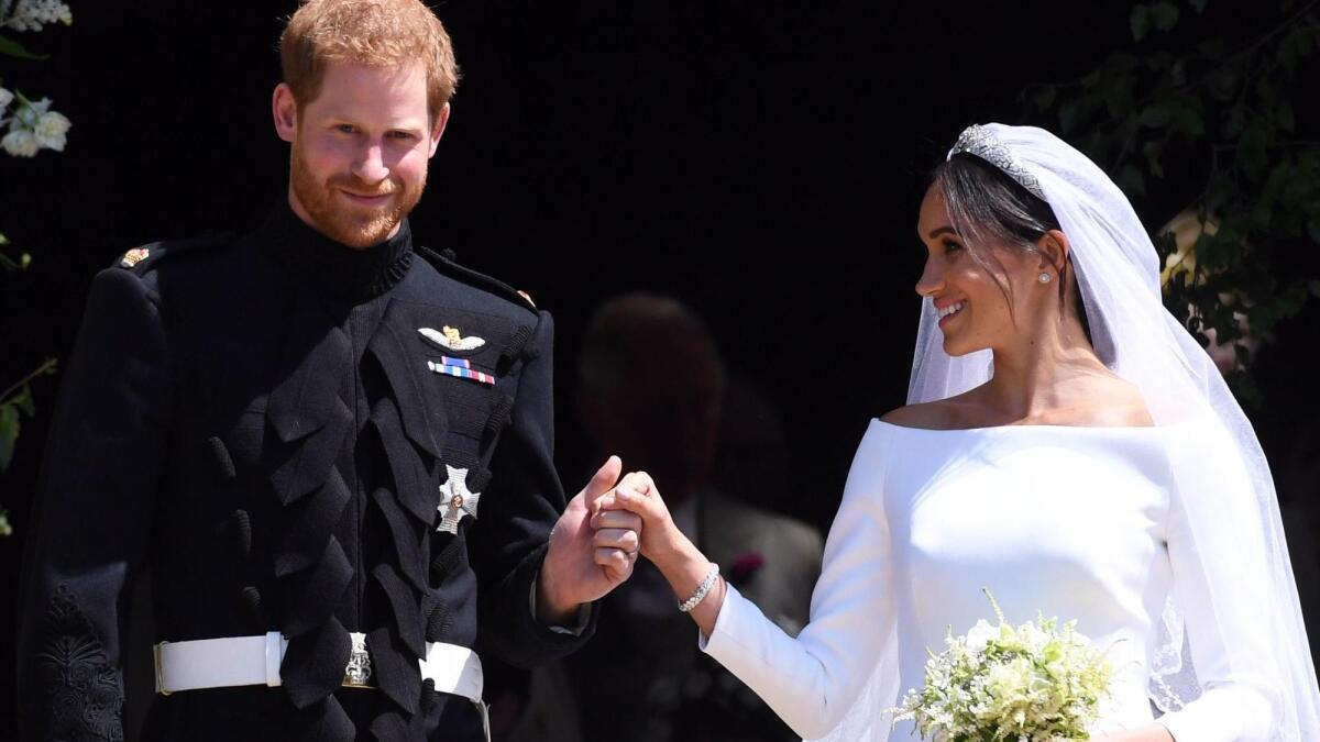 Prince Harry and Meghan Markle are wed amid pomp and