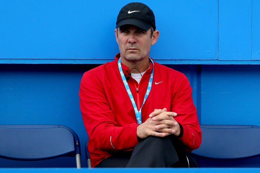 Paul Annacone watches Sloane Stephens play Caroline Wozniacki during the Aegon International.