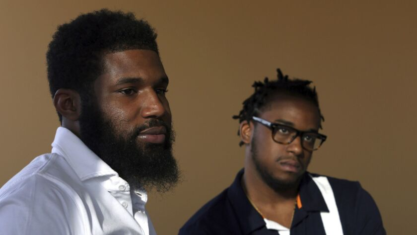 Rashon Nelson, left, and Donte Robinson listen to a reporter's question in Philadelphia.