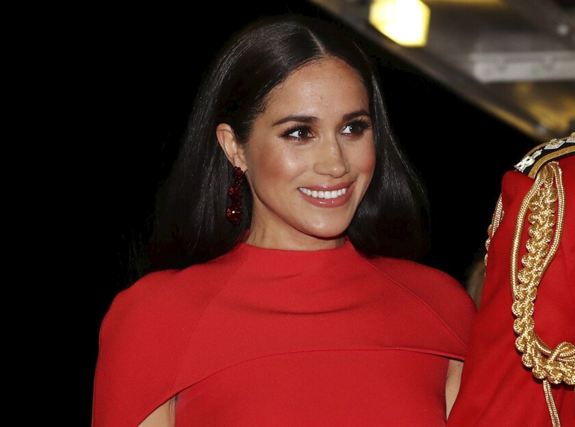 In this March 2020 file photo, Meghan, Duchess of Sussex with Prince Harry arrives at the Royal Albert Hall in London.