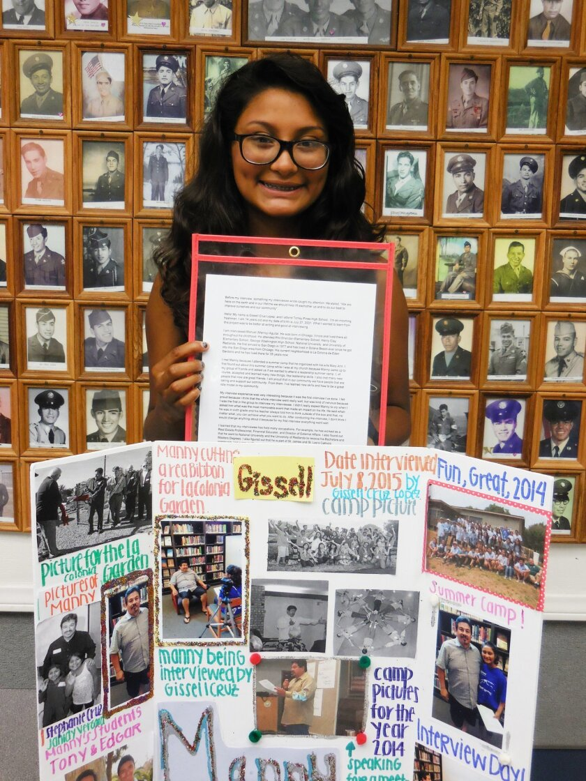 Gissell Cruz holds the project board she created after interviewing a community member.