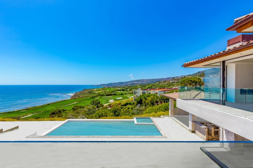 The under-construction home is one of just 36 residences and one of two modern builds at the Estates at Trump National golf community in Rancho Palos Verdes.