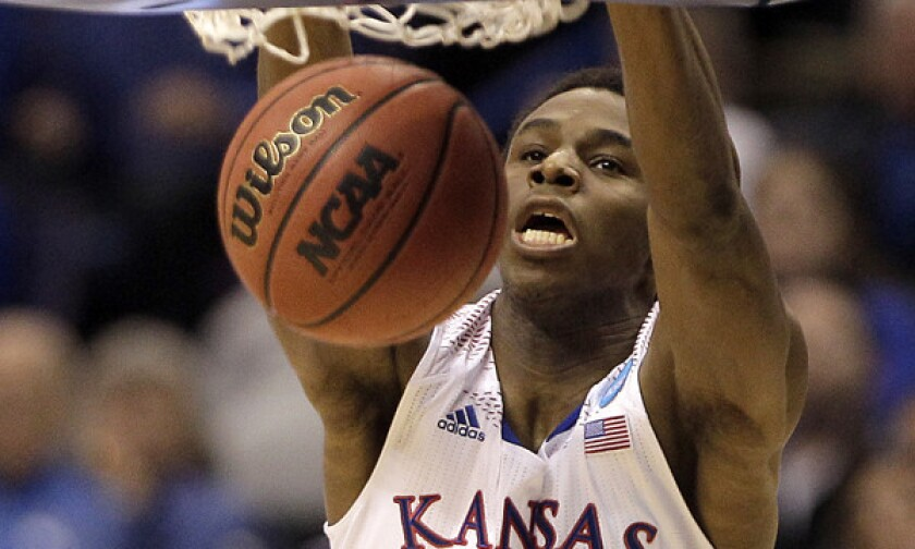 The pool of players in the draft could include Andrew Wiggins, shown here dunking during the Jayhawks' 80-69 NCAA tournament win over Eastern Kentucky on March 21.