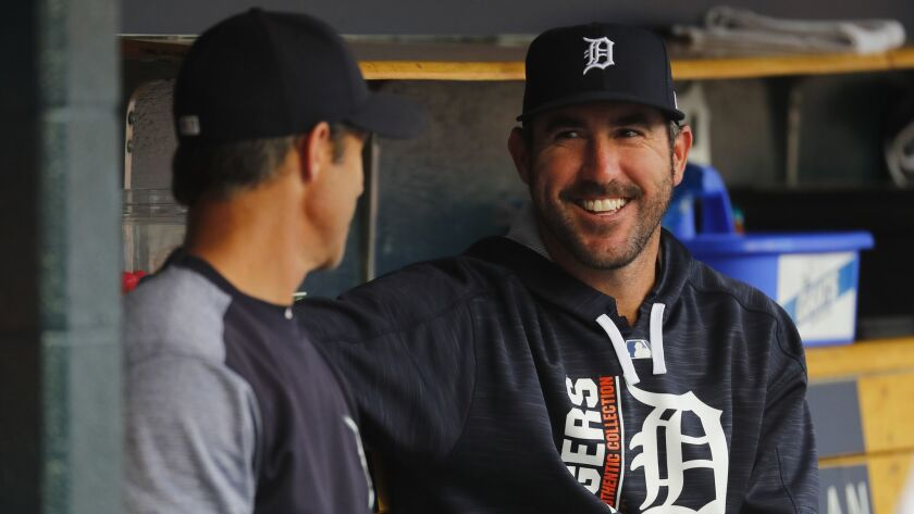 Pitcher Justin Verlander, right, talks with manager Brad Ausmus when both were with the Detroit Tigers in 2017. Ausmus is the Angels manager and Verlander is with the Houston Astros.