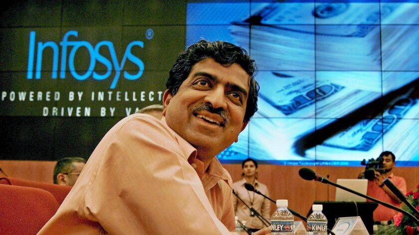 "Indian billionaire Nandan Nilekani, shown in 2006, calls the Aadhaar biometric database that he helped create ""hugely empowering"" for the poor."
