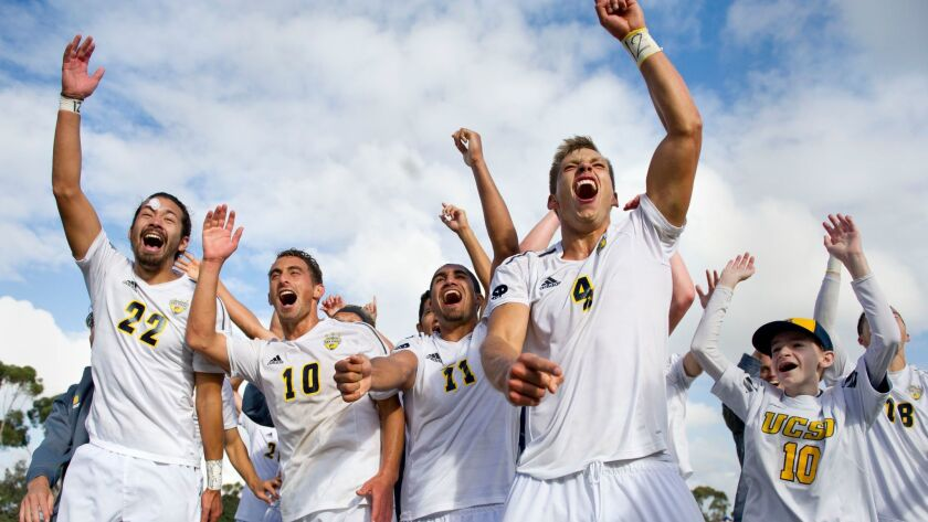 The Tritons celebrate after defeating Midwestern State 2-1 in the NCAA Division II quarterfinals.
