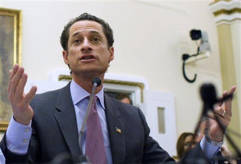 """FILE - In this Jan. 6, 2011 file photo, Rep. Anthony Weiner, D-N.Y., testifies before the House Rules Committee on Capitol Hill in Washington. A spokesman for Weiner on Sunday, May 29, 2011 said that a lewd photograph sent from the Democrat's Twitter account is just """"a distraction"""" perpetrated by a hacker.(AP Photo/Harry Hamburg, File)"""