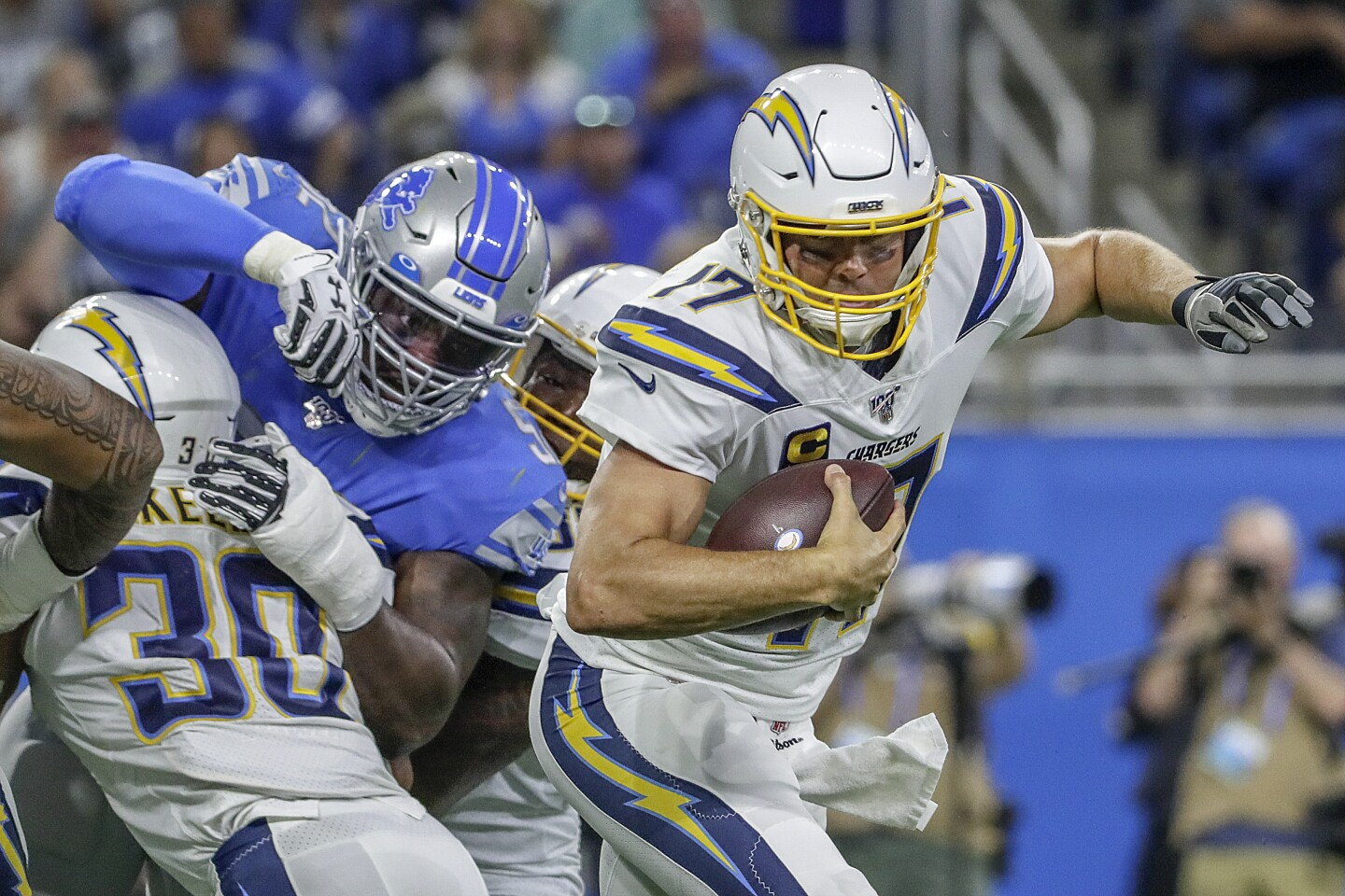 DETROIT, MICHIGAN, SUNDAY, SEPTEMBER 15, 2019 - Chargers quarterback Philip Rivers scrambles away from Lions linebacker Christian Jones during a third quarter drive at Ford Field. (Robert Gauthier/Los Angeles Times)