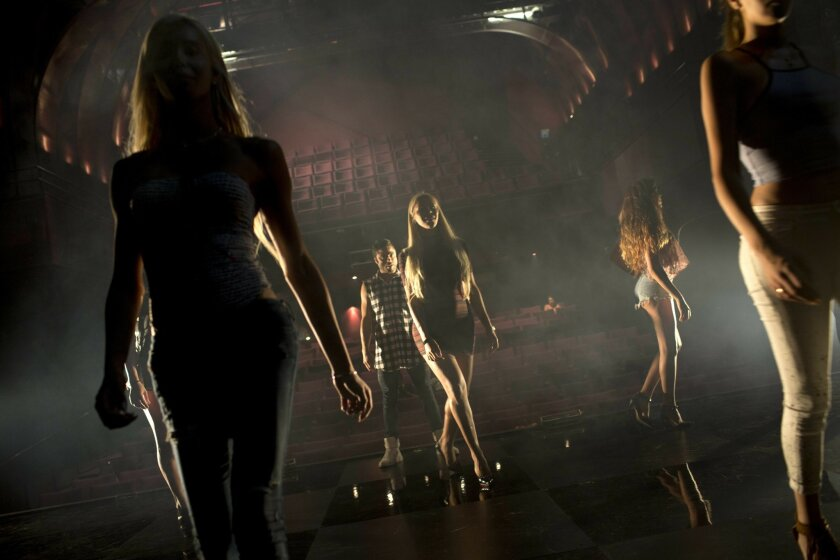 Contestants in the first Miss Trans Israel beauty pageant practice the walk on the stage during rehearsal in Tel Aviv, Israel, Thursday, May 26, 2016. The pageant will be held at HaBima, Israel's national theater, in Tel Aviv on Friday. Tel Aviv has emerged as one of the world's most gay-friendly t