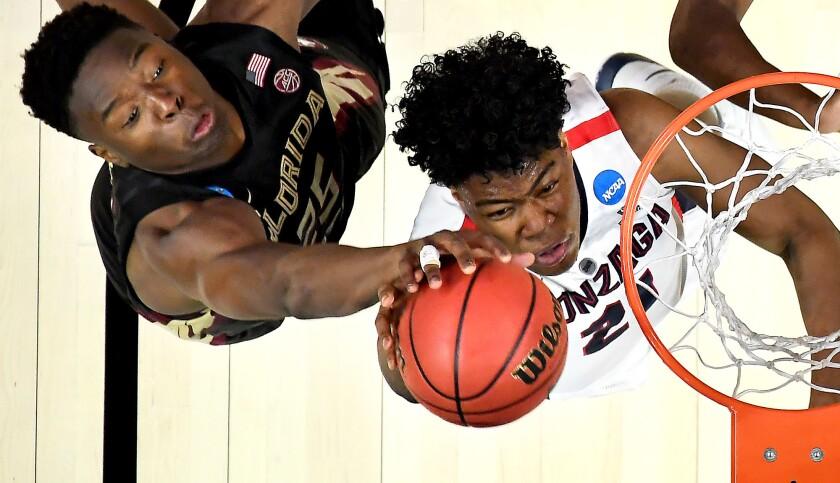 Florida State center Mfiondu Kabengele blocks the shot of Gonzaga forward Rui Hachimura during an NCAA tournament game