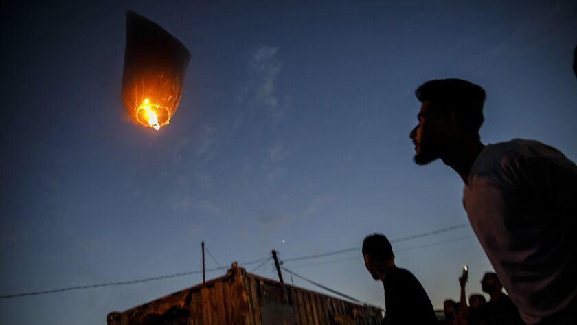 Palestinians watch incendiary balloons and kites fly from the Gaza Strip on May 9.