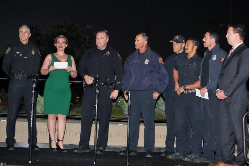 Representatives from the SD Police Dept Northwest Division and from SD Fire Station #24 are recognized for their support of the community with a donation from the Del Mar Highlands Town Center