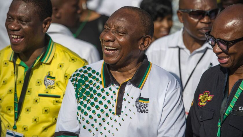 The African National Congress ruling party's newly elected president, Cyril Ramaphosa, arrives to take part in the fourth day of the party's conference, on Dec. 19, 2017.