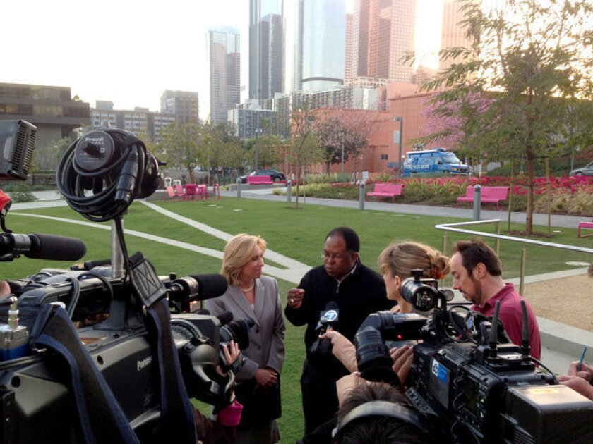 Mayoral candidate Wendy Greuel and Los Angeles County Supervisor Mark Ridley-Thomas talk to the press Sunday night.