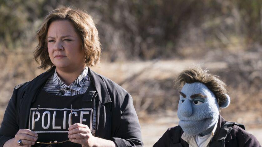 "Melissa McCarthy (left) stars in ""The Happytime Murders."" Credit: Hopper Stone / STX Entertainment"