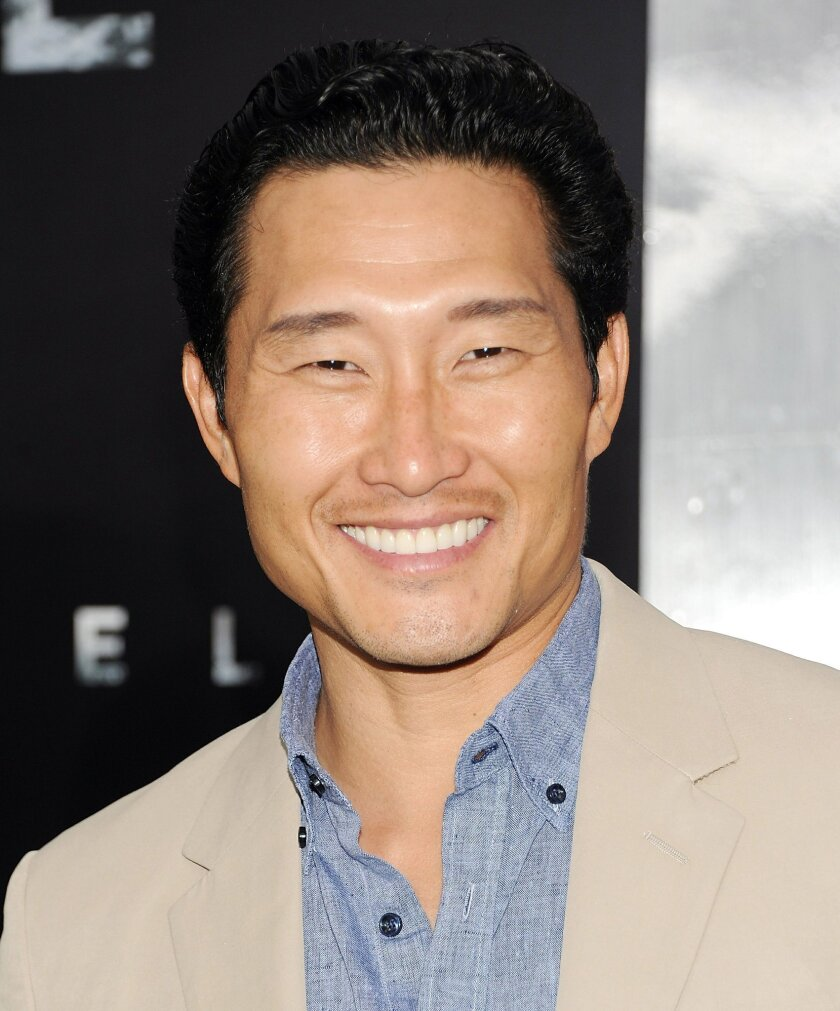 """FILE - In this June 10, 2013 file photo, actor Daniel Dae Kim attends the """"Man Of Steel"""" world premiere at Alice Tully Hall, in New York. The former """"Lost"""" star makes his directorial debut with Friday, Feb. 27, 2015, episode of the CBS crime drama, """"Hawaii Five-O."""" (Photo by Evan Agostini/Invision/AP, File)"""