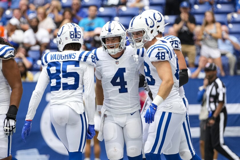 Indianapolis Colts quarterback Sam Ehlinger (4) celebrates after a two-point conversion against the Carolina Panthers during the second half of an NFL football game in Indianapolis, Sunday, Aug. 15, 2021. (AP Photo/AJ Mast)