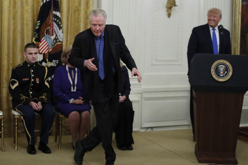 Jon Voight dances as President Donald Trump looks on
