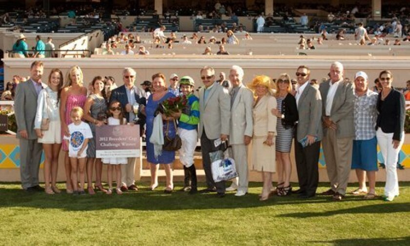 In the Del Mar winner's circle following Rail Trip's victory in the Grade II, $200,000 San Diego Handicap on July 28. At left is trainer Ron Ellis. Breeders' Cup president Craig Fravel is presenting the trophy to Samantha Siegel (center holding the red roses) with jockey Jose Valdivia. BENOIT PHOTO