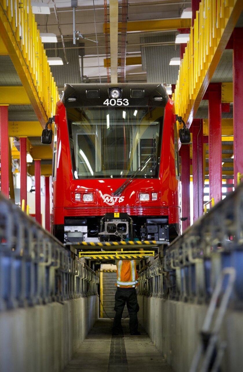 At the MTS trolley maintenance yard in downtown San Diego, Ron Parsario from Siemen works on one of the newest SD8 Short trolley trains recently added to the San Diego Metropolitan Transit System's fleet of trolleys.