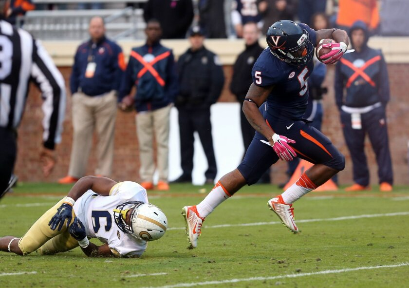 Virginia quarterback David Watford (5) gets past Georgia Tech defensive back Chris Milton (6) for the touchdown during the second half of an ACC college football game at Scott Stadium, Saturday, Oct. 31, 2015, in Charlottesville, Va. (AP Photo/Andrew Shurtleff)