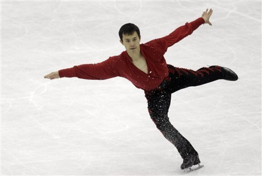 Patrick Chan of Canada performs during his men's free skating program at the 2012 World Figure skating Championships in Nice, southern France, Saturday, March 31, 2012. (AP Photo/Lionel Cironneau)