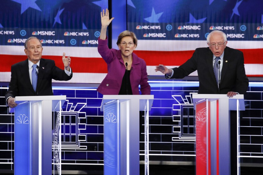 Democratic presidential candidates Mike Bloomberg, left, Elizabeth Warren and Bernie Sanders in Wednesday's debate, which drew 19.7 million viewers for NBC and MSNBC.