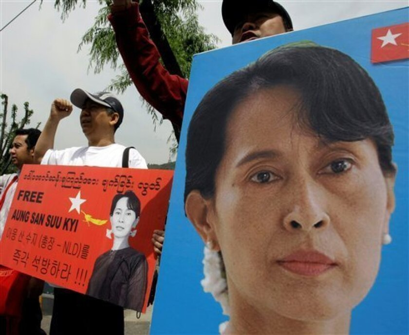 Myanmar activists shout slogans during a rally demanding the immediate release of their pro-democracy leader Aung San Suu Kyi, in front of the Myanmar Embassy in Seoul, South Korea, Saturday, May 30, 2009. Detained pro-democracy leader Aung San Suu Kyi urgently needs medical attention in the Myanma