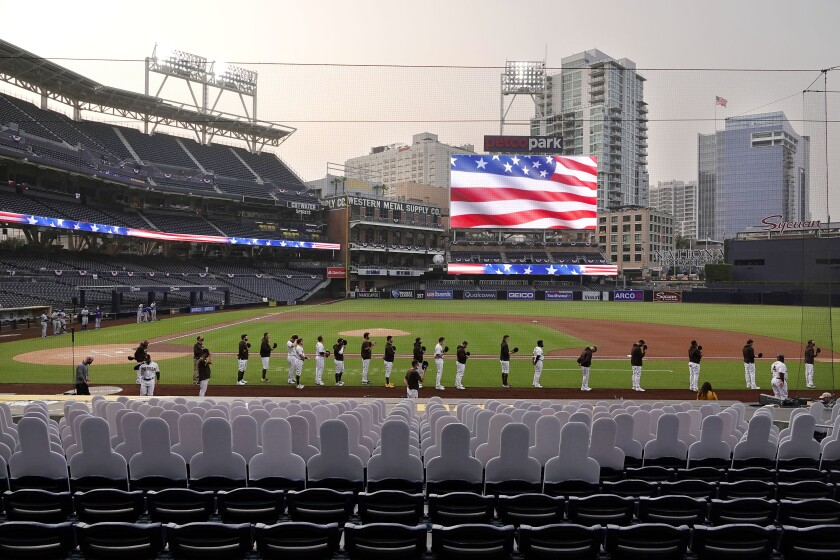 The San Diego Padres stand for the national anthem before Monday's game at Petco Park.