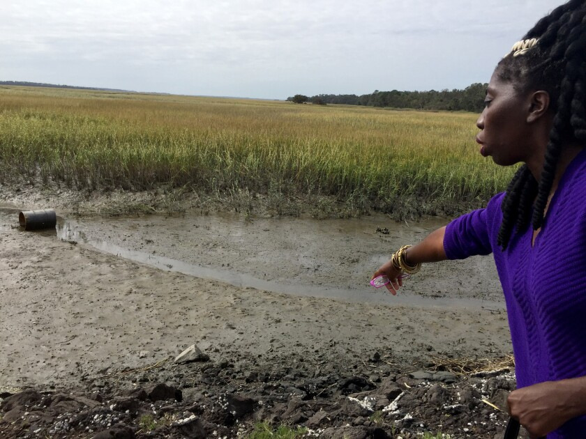 Marquetta Goodwine, chieftess of the Gullah people, points to flooding effects on the salt marshes that line the Sea Islands of South Carolina.
