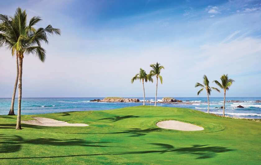 The 18th hole at Punta Mita's Pacifico course offers golfers stunning views of the Pacific Ocean.