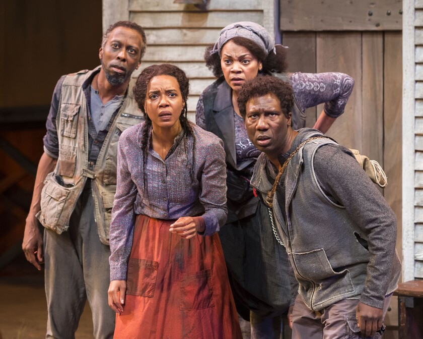 """Julian Rozzell Jr., Sameerah Luqmaan-Harris, Tonye Patano and Russell G. Jones in """"Father Comes Home From The Wars (Parts 1, 2 & 3)"""" at Center Theatre Group/Mark Taper Forum."""