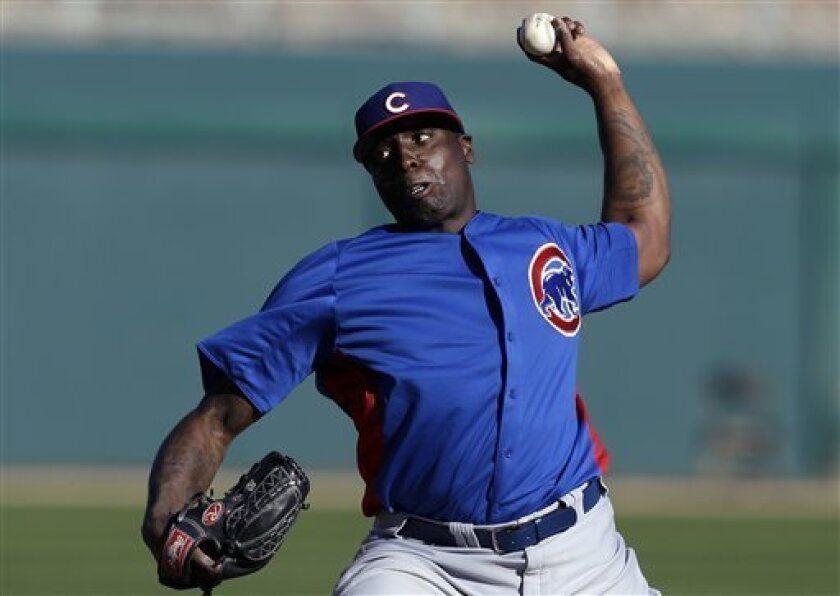 Chicago Cubs pitcher Dontrelle Willis throws against the Los Angeles Dodgers in the eighth inning of a exhibition spring training baseball game in Glendale, Ariz., Monday, Feb. 25, 2013. (AP Photo/Paul Sancya)