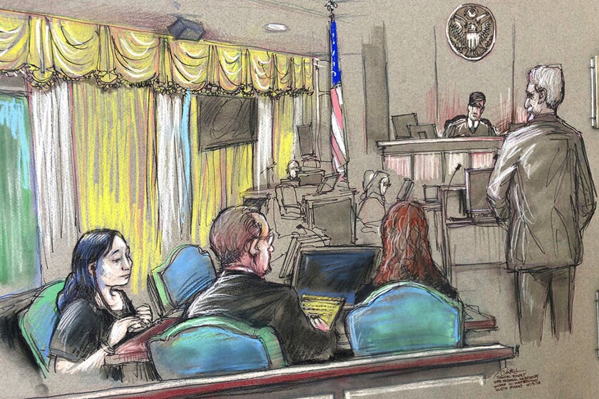 In this April 15 courtroom sketch, Yujing Zhang, left, a Chinese national charged with trespassing at President Trump's Mar-a-Lago resort, listens to a hearing before Magistrate Judge William Matthewman in West Palm Beach, Fla.