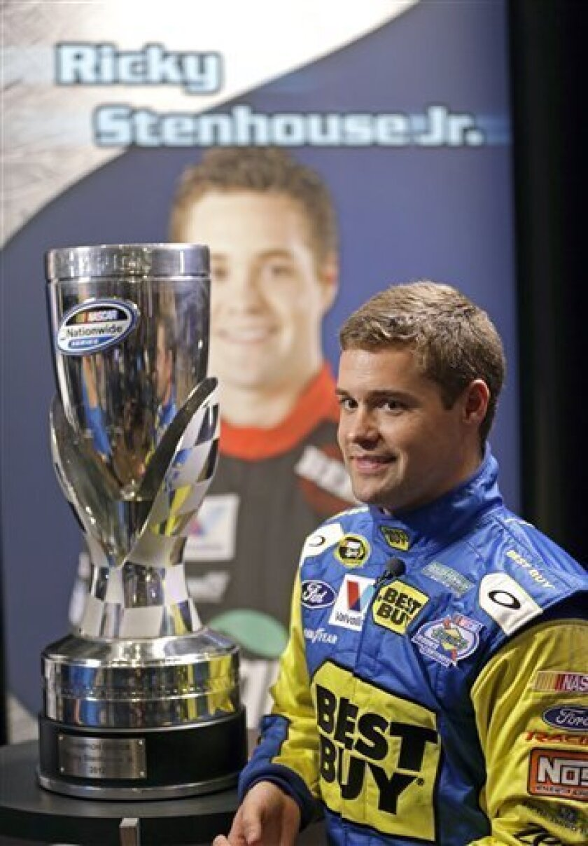 Ricky Stenhouse Jr. takes part in a television interview, with his Nationwide Series championship trophy during NASCAR media day at Daytona International Speedway, Thursday, Feb. 14, 2013, in Daytona Beach, Fla. (AP Photo/John Raoux)