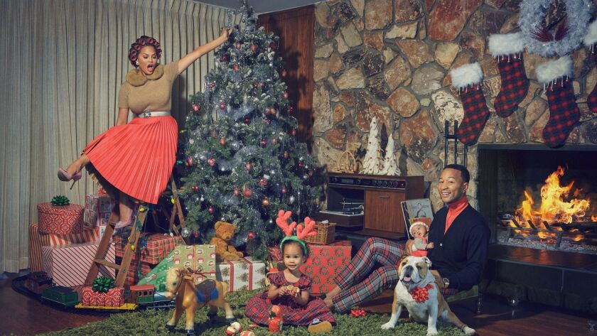 "The cover of John Legend's album ""A Legendary Christmas"" features the singer, his wife, Chrissy Teigen, daughter Luna Simone Stephens and son Miles Theodore Stephens. Teigen writes about traveling with children for Conde Nast."