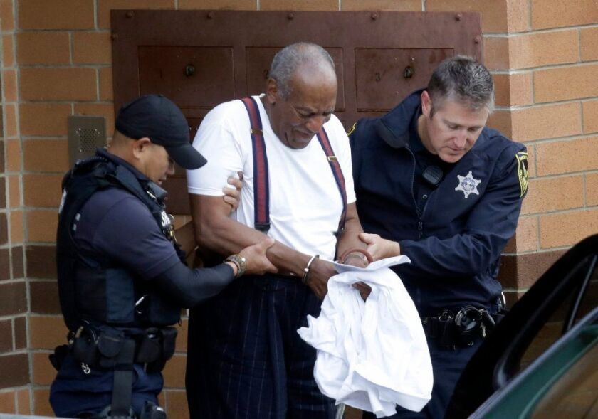 Bill Cosby is escorted out of the Montgomery County Correctional Facility in Eagleville, Pa., on Sept. 25 following his sentencing to three-to-10-year prison sentence for sexual assault.