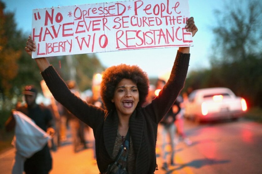 A demonstrator in Ferguson, Mo.