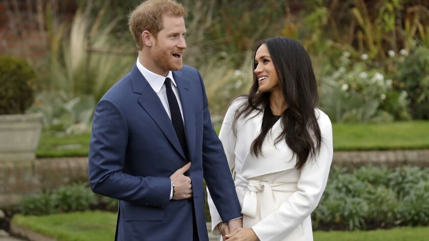 FILE - In this file photo dated Monday Nov. 27, 2017, Britain's Prince Harry and fiancee Meghan Mark