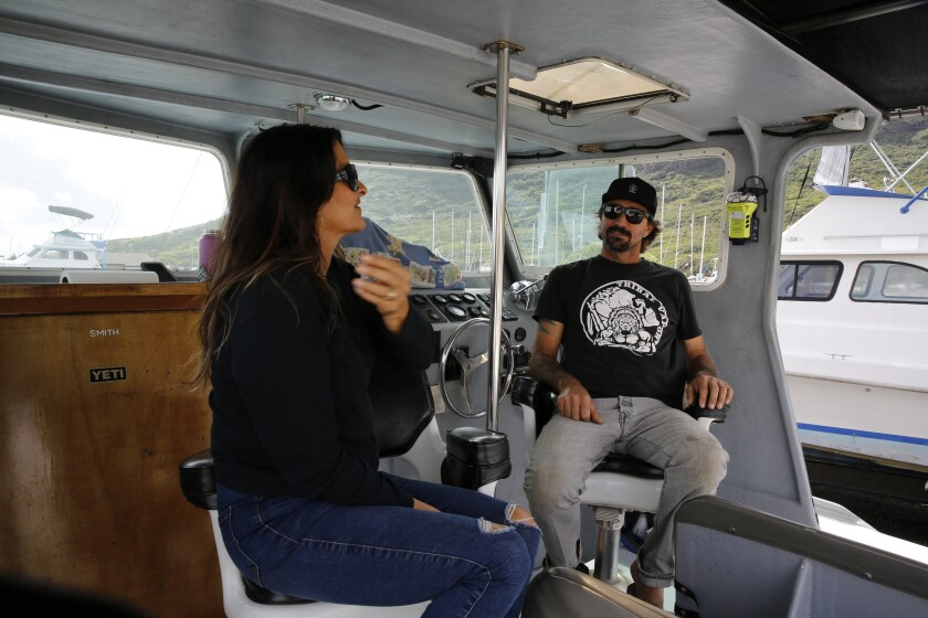 Cynthia and Lance Keener sit on their boat on the island of Kauai.