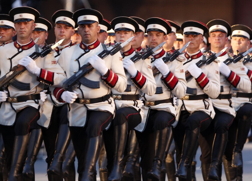 Army honor guard soldiers march during a parade to mark the Independence Day in downtown Skopje, North Macedonia, Wednesday, Sept. 8, 2021. North Macedonia is celebrating Wednesday the 30th anniversary since its independence from former Yugoslavia. (AP Photo/Boris Grdanoski)