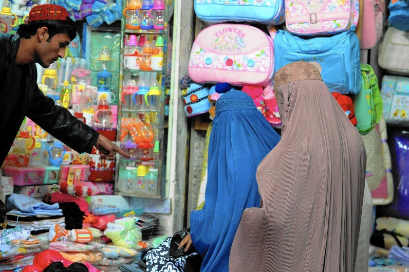 Burqa-clad Afghan women shop at a bazaar in Kandahar. With the official end of U.S. combat operations after 13 years of war, a federal auditor has concluded it is unclear how much Afghan women have benefited from U.S. efforts to help them or even how much has been spent on them.